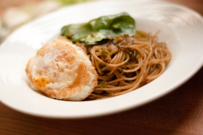 spaghettini pasta with green garlic poached egg and miner's lettuce